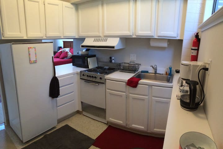 The kitchen is fully equipped. Including: electric oven/stove, coffee maker, water-boiler, microwave, sink disposal, pots/pans/dishes.