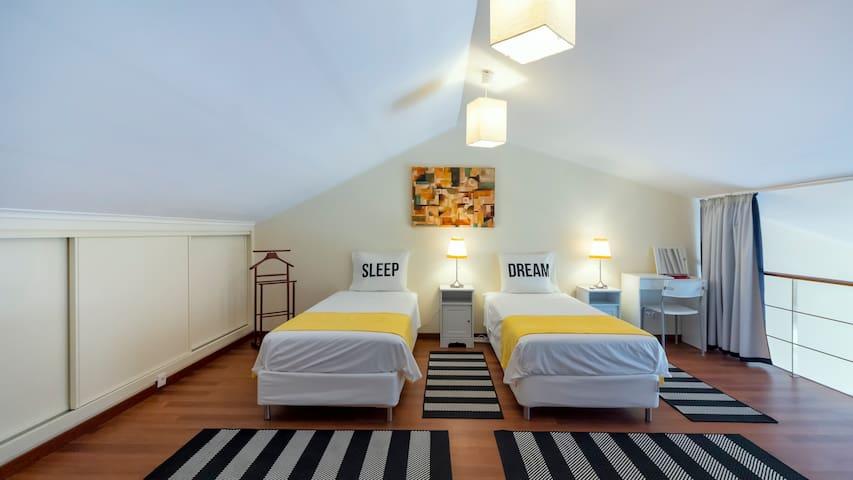 Bedroom on the mezzanine with three single beds