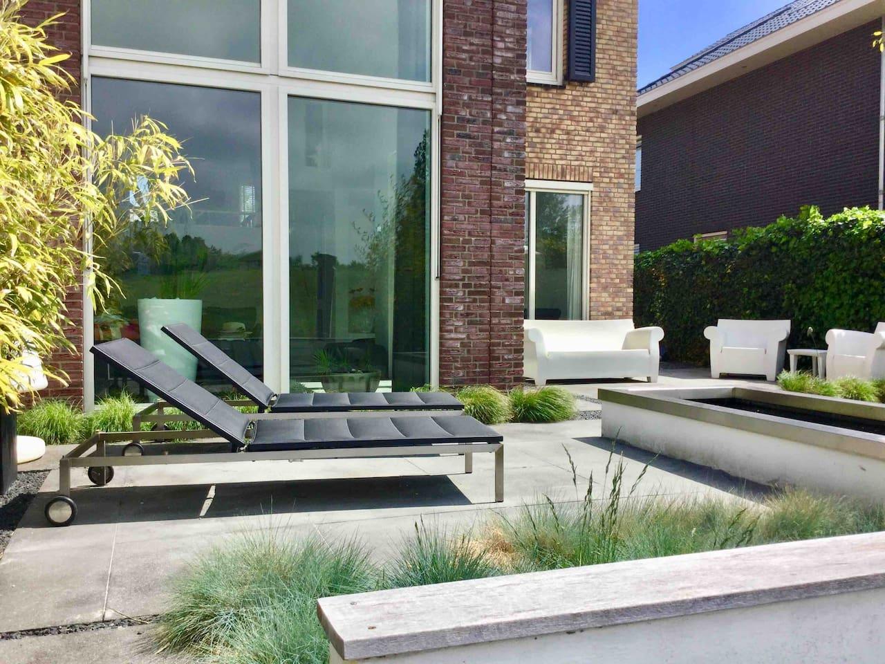 Sunny backyard of modern comfortable house near Amsterdam and Haarlem