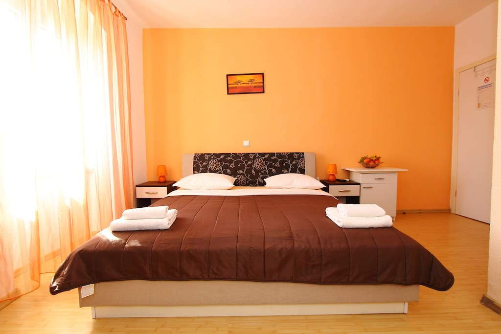 Orange room with double bed