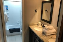 Modern bathroom with a pocket door separating the vanity area from the toilet/shower. Super handy when vacationing with multiple families.