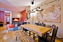 """Our communal living room and dining area with world map & 55"""" 4K HDTV"""