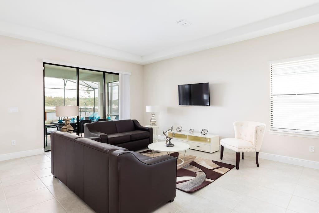 Retreat back to the cozy living room and catch a movie on the wall-mounted flatscreen TV.