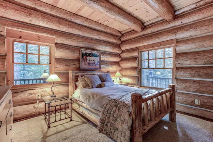 The other downstairs bedrooms offers a cozy queen bed.