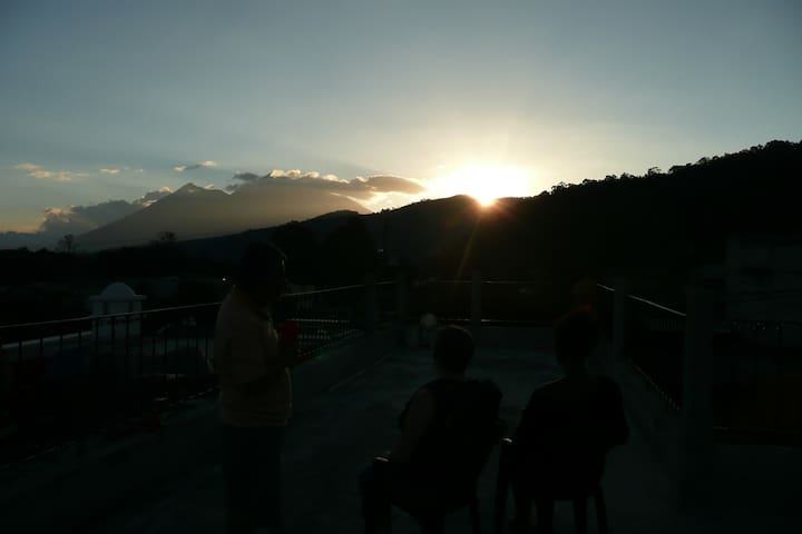Enjoy the sunset in the roof terrace with a beer or wine, after a walk in Antigua