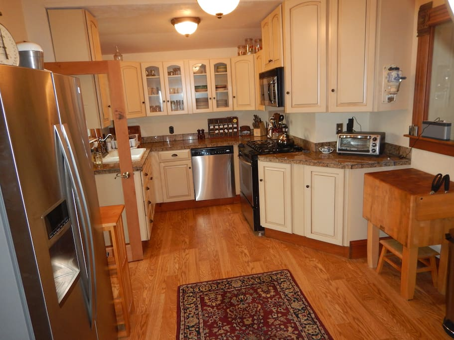 Kitchen with gas stove, dishwasher, microwave, refrigerator