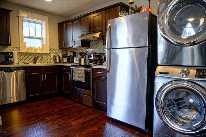 Full size washer and dryer situated next to the fridge so you're able to do laundry, if needed.