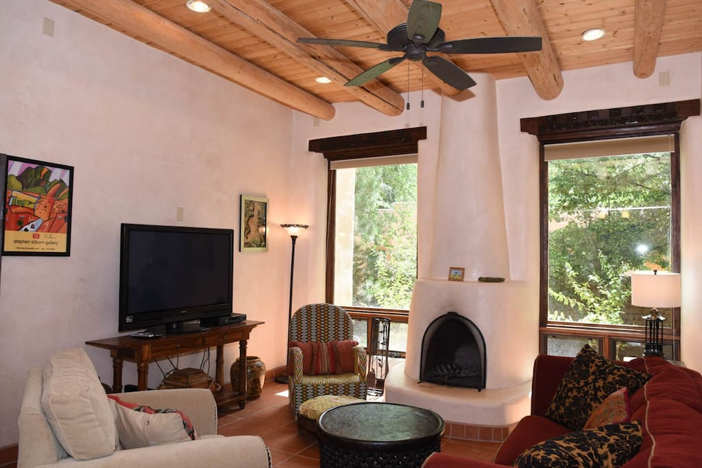 Spacious yet cozy living room with working kiva fireplace