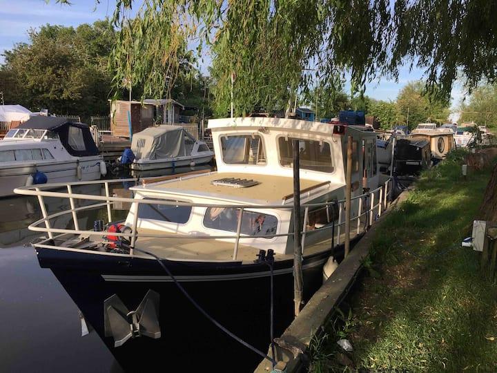 lovey dutch boat at river pub mooring
