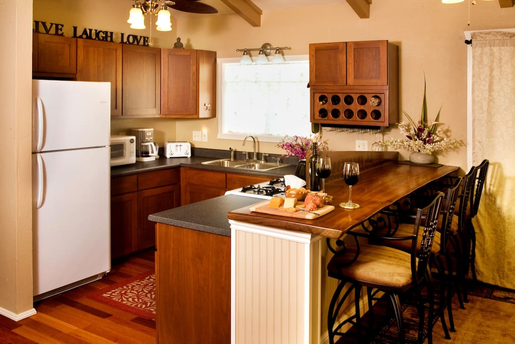 Fully equipped kitchen with cherry cabinets.