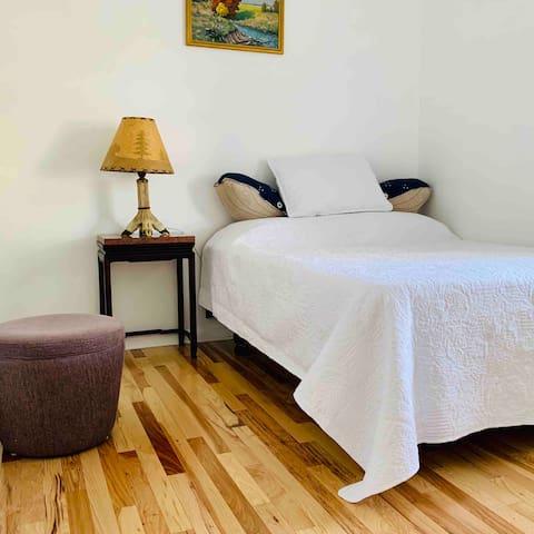 Full size bedroom: clean, fresh, simple.