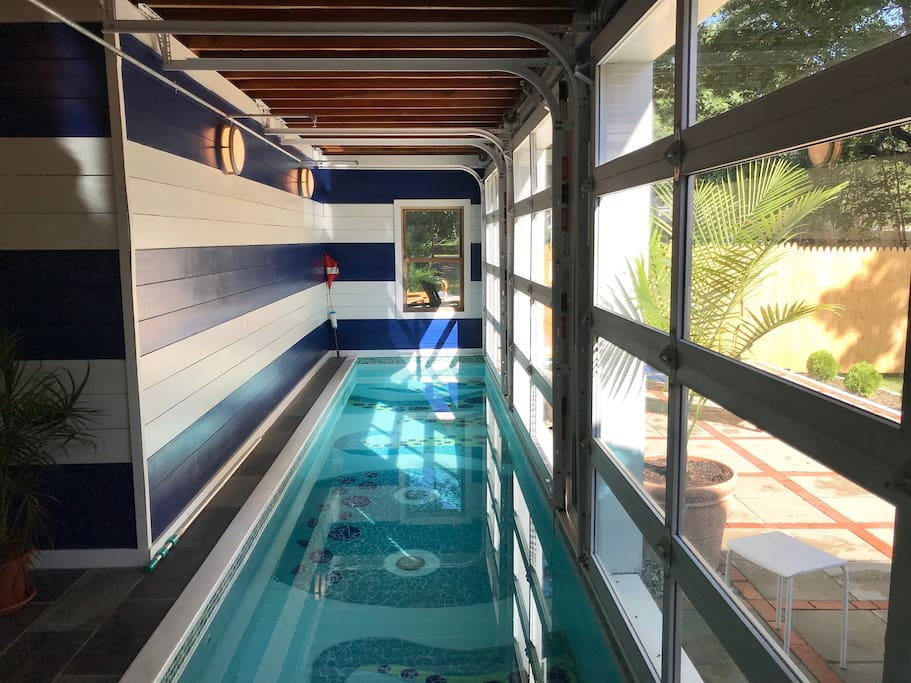 36' lap pool with 3 glass doors opening to outdoor patio