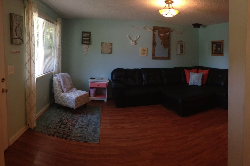 The living room is calm and inviting, with plenty of comfortable seating.