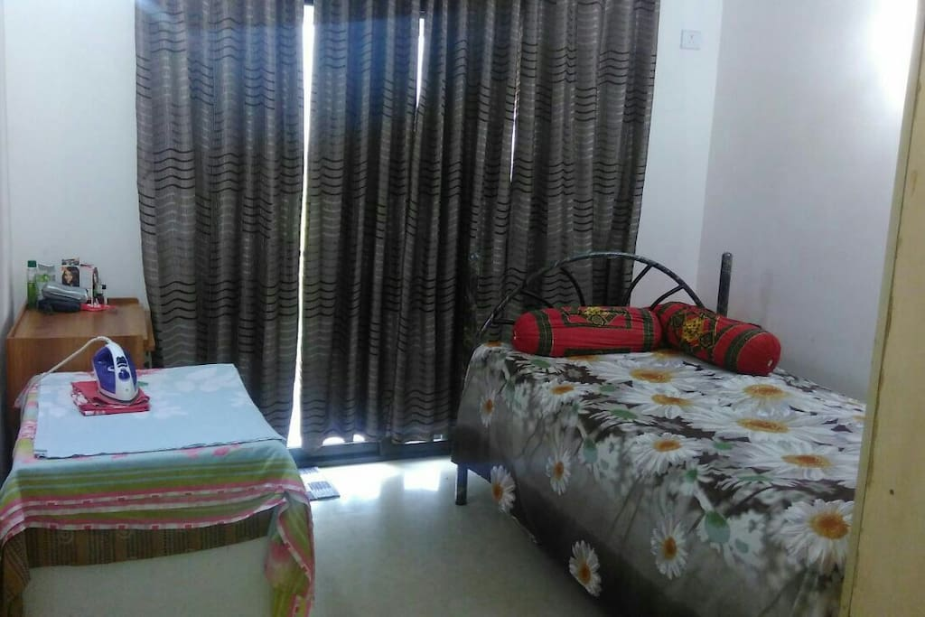 Spacious Room with Ironing Table, Cupboard and Balcony.