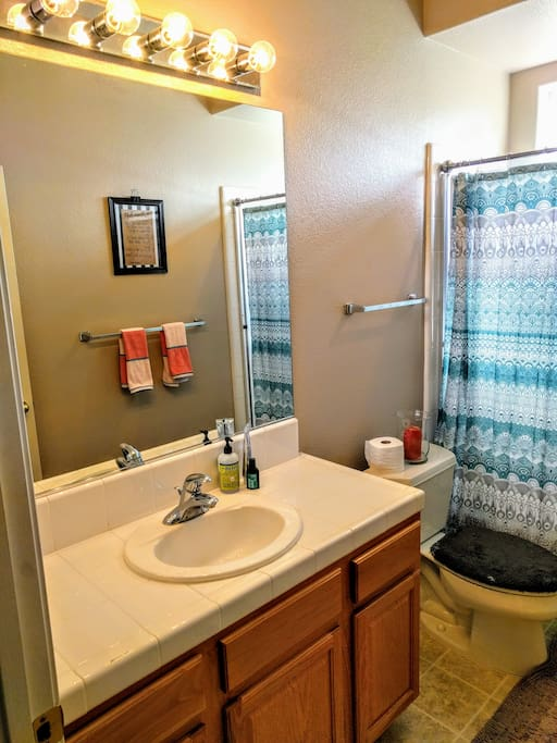 Bathroom is accessible from hallway. It is available to all guests, but has a privacy lock. Inquire if you would like to know how many guests are staying in the house. Also, Master Bedroom has its own bathroom. Each bathroom is stocked with Shampoo, toothpaste, hand soap, and clean hand towels on check in.