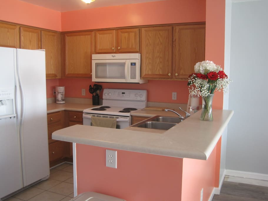 Colorful kitchen is ready for big or small meals.