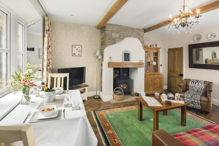 """Guest comments """"Warm and cosy"""" """"We especially appreciated the documented history and photos of the restoration"""" """"Such a great piece of history"""" """"A wonderful comfy cottage. We loved it"""" """"Simply amazing, you won't be disappointed"""" """"Excellent amenities"""""""