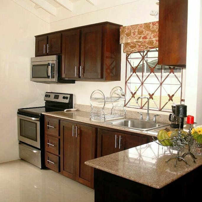 Kitchen fully equipped with stainless steel appliances