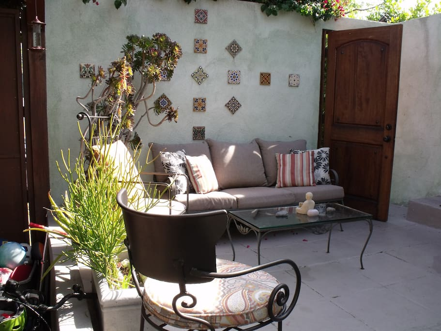 One of the patio seating areas, off the main door to the living room and bedroom number 2.