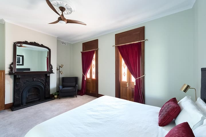 The very spacious master bedroom has a King Size bed, double doors on to the balcony, sitting corner and this mantlepiece and mirror. Together with Yamaha clock radio and bluetooth speaker for quality sound.