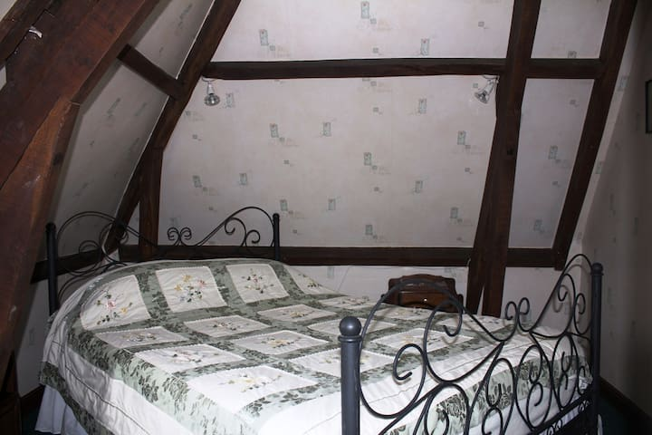 Bedroom with double bed and fantastic view over the valley