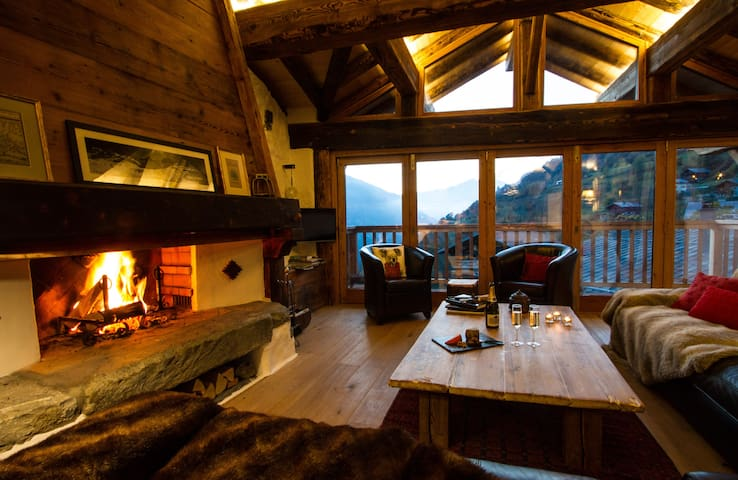 The warm, solid wooden beams frame the beautiful view outside