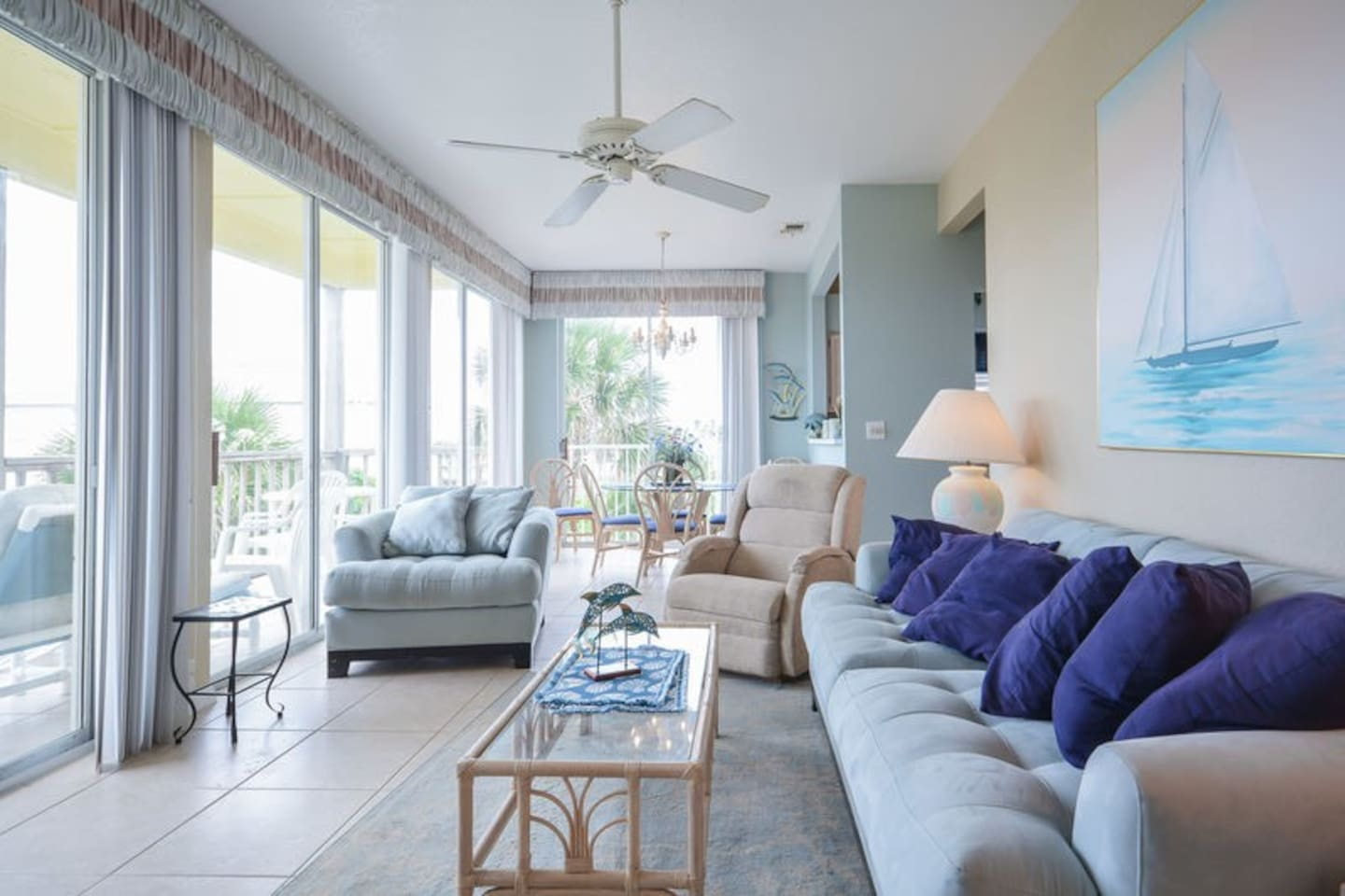 Ocean view living room with flat screen TV, DVD and recliner.