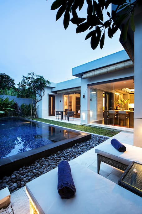 Poolside View of Villa Bedroom and Dining Room