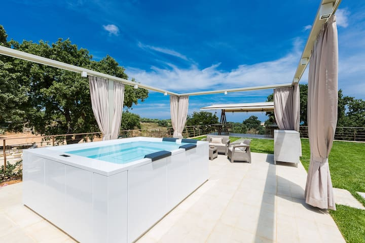 To make things even better, the terrace is complemented by a huge,  5 seater  Jacuzzi tub (2,80X2,35 m, which will offer you endless hours of relaxation during the hot days and nights!