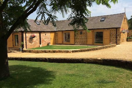 Luxury converted barn in a village farm location.