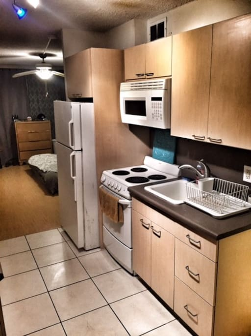 Sink, stove/oven, and refrigerator.