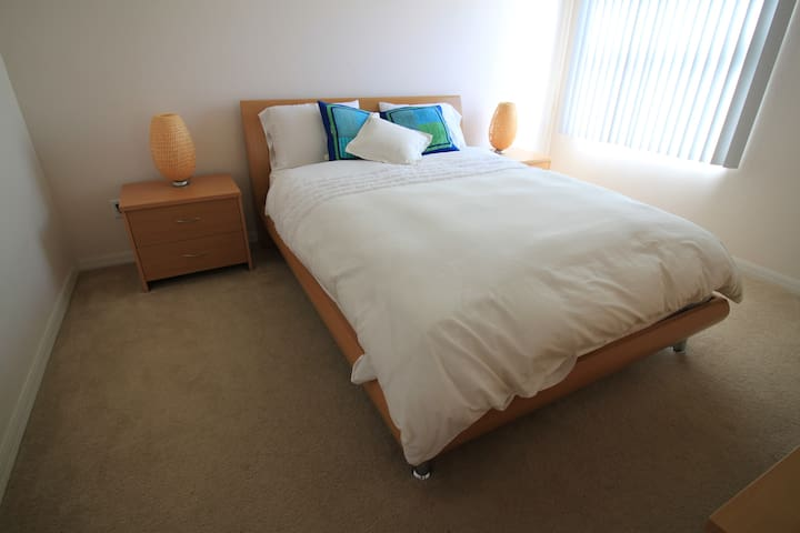 Bedroom 2 - a queen size double bed with a walk-in wardrobe