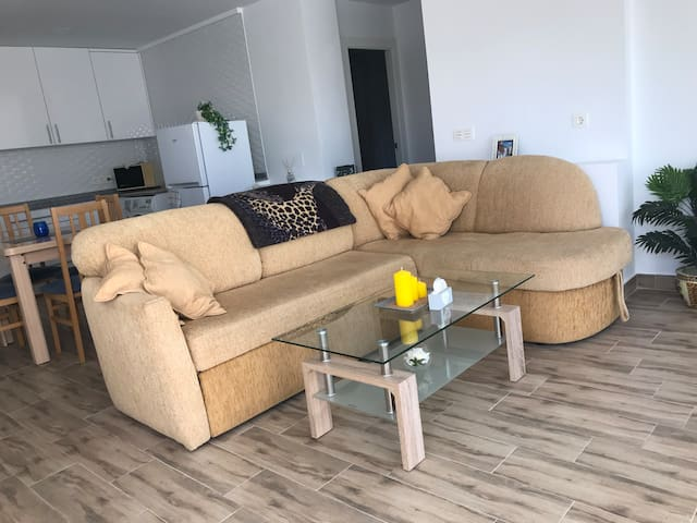 Lounge with large sofa (opens up to double bed). TV, DVD. Glass bi fold doors open on to patio and view of orange groves, distant sea view of Guardamar town. Patio and garden, outdoor table/chairs.