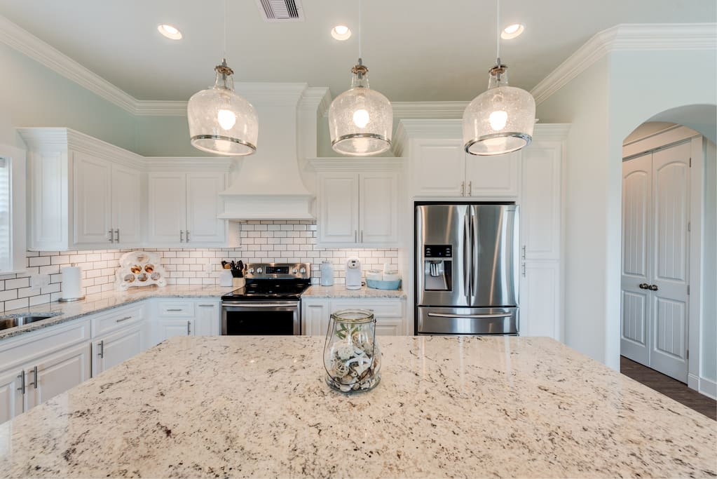 Nicely appointed kitchen. Stocked with everything you will need to cook for your stay: cookware, utensils, dishes, bowls, cups etc. as well as small appliances: coffee maker (Keurig, toaster, blender)