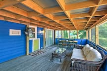 You're sure to love the large furnished screened-in porch!
