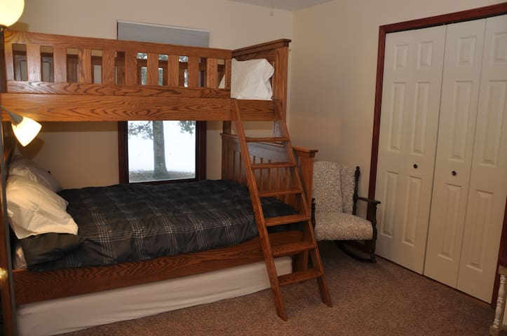 The third bedroom has a double/single bunk