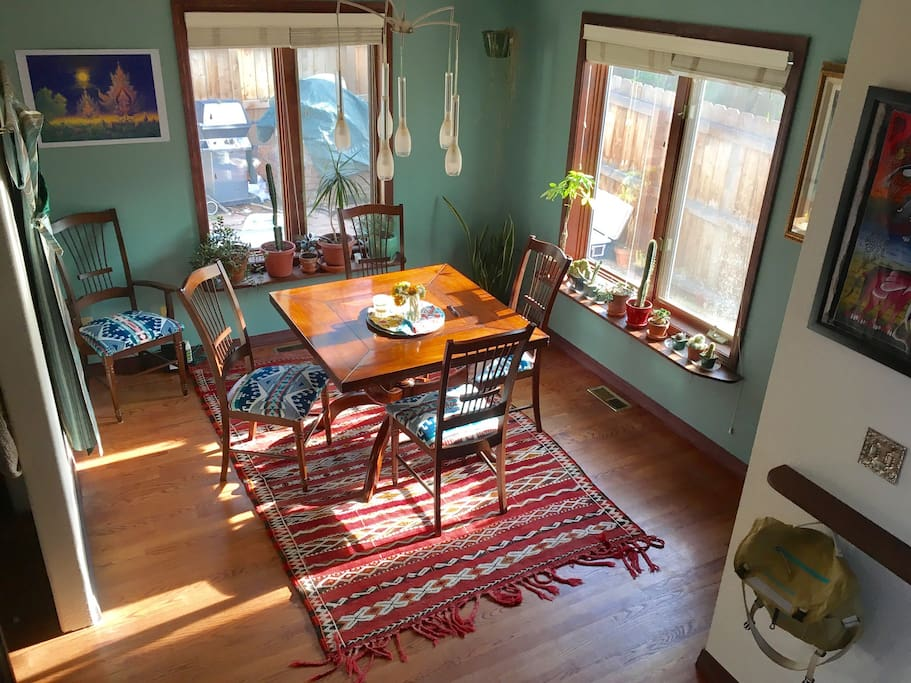 Dining room with afternoon sun and expandable table up to 8.