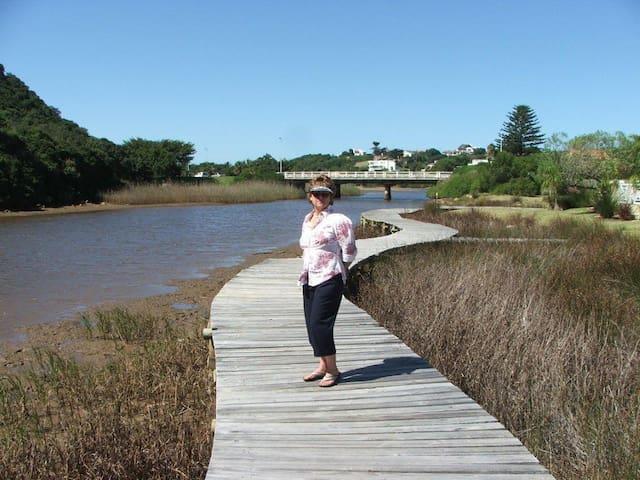 Enjoy the boardwalk along the river edge