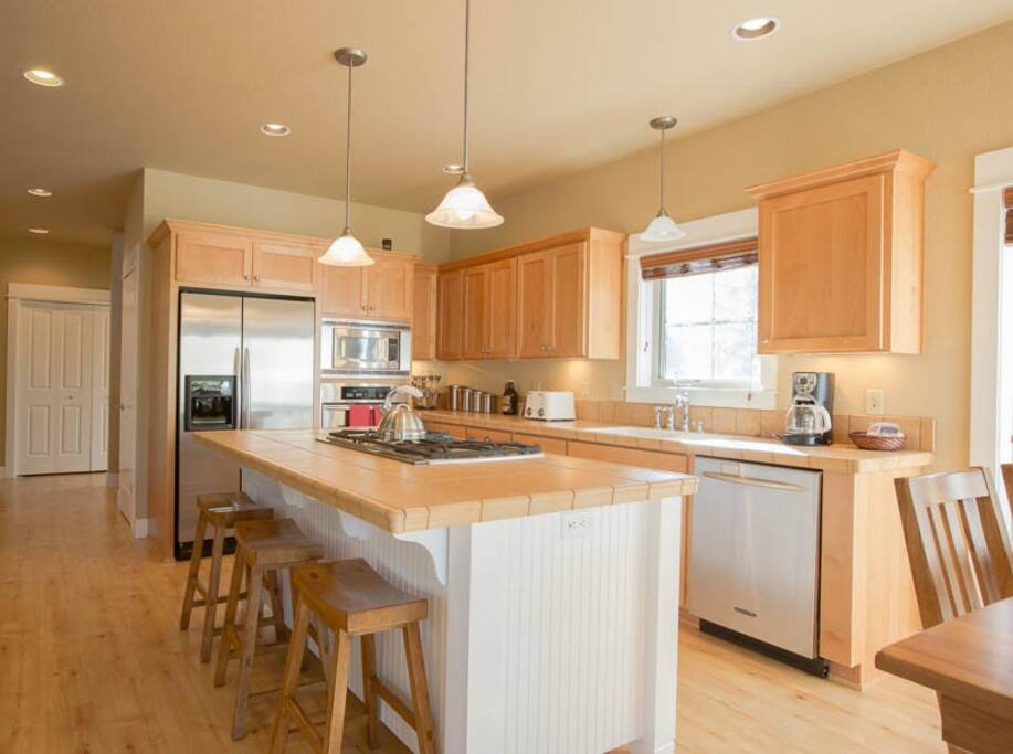 Functional Kitchen that opens to Living Room and Dining Room.  Large Bay Windows Surround the Home.