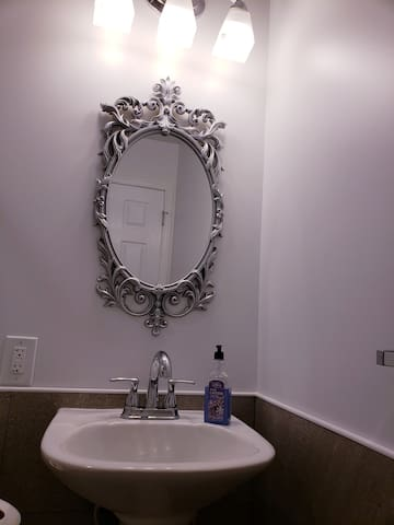 En suite bathroom has contemporary design with attention to detail