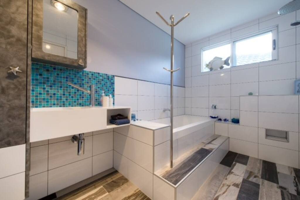 Your bathroom with rain-shower, heated flooring (if required), hairdryer, draw-space, heated towel rail and toiletries.
