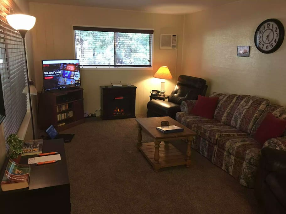 Large spacious living room, with TV, DVD/VHS player and fireplace. W e
