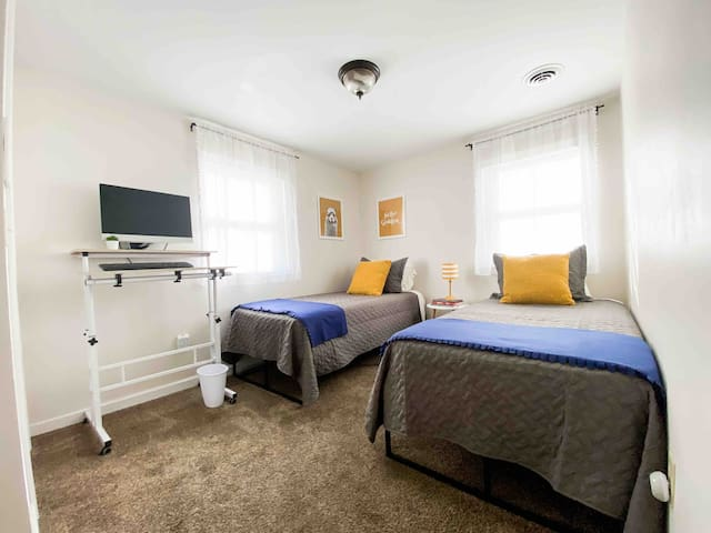 The smaller bedroom features two standard plush twin mattresses for a comfortable night's sleep!