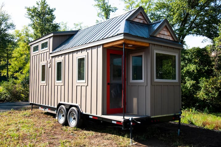 This cute, cozy tiny home is super charming with short walks to creeks, a shared fire pit, and more.