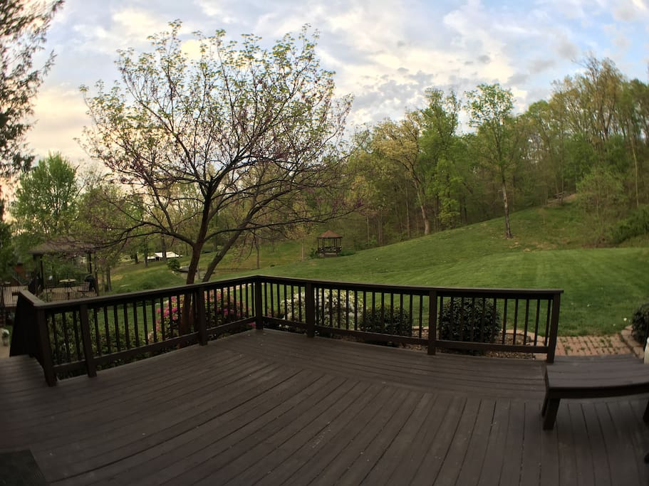 deck overlooking wooded property
