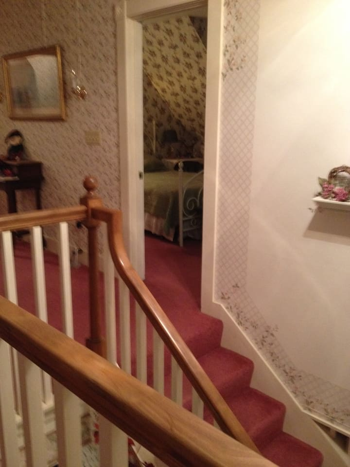 At the top of the stairs is the guest room usually reserved for family members, it is occasionally made available by special request for our Airbnb guests.