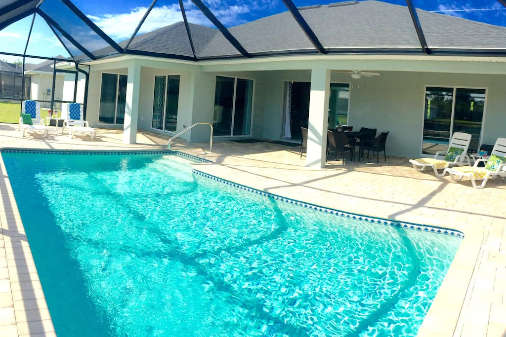 Enjoy the screened in swimming, sun bathing,  grilling and dining.  Pool heated to 88 F