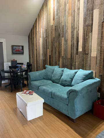 This is the new sleeper sofa, it's a queen! The condo offers three other queen size beds! One across from this one in what was the dining room, one in the bedroom behind the photographer and one upstairs in the loft bedroom.