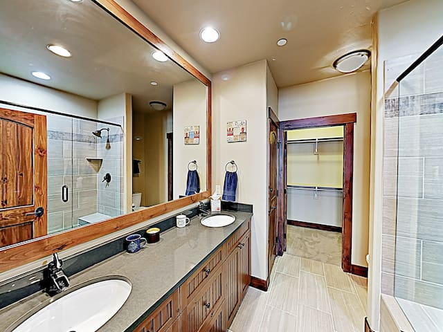 The master bathroom offers a spacious double vanity.