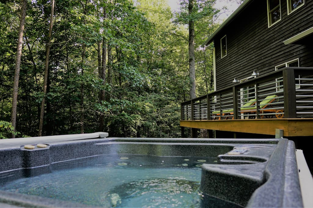 Relax in the outdoor hot tub. 2-3 people (4 if you're friendly). Yes, we provide bathrobes!